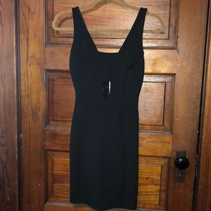 Black mini dress with open back and front